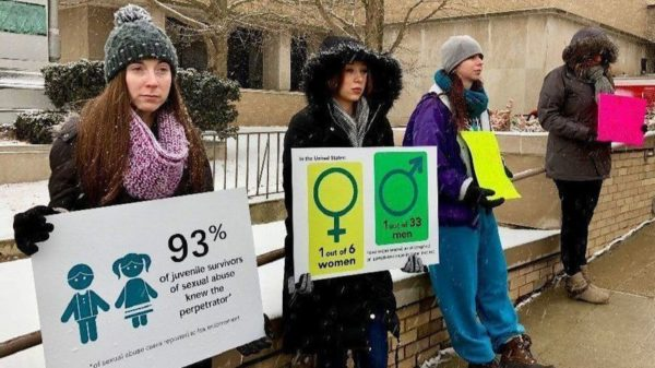 Ashley Dawson of Wauconda, foreground, is among those participating in a Zacharias Sexual Abuse Center demonstration Monday to draw attention to sexual assault survivors as part of Sexual Assault Awareness Month. (Jim Newton / Lake County News-Sun)